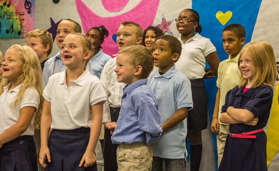 Children singing at A+ Academy Community School
